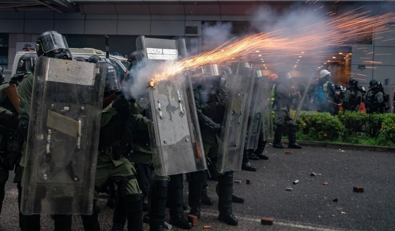 Live ammunition petrol bombs and water cannons mark violent escalation in Hong Kong protests