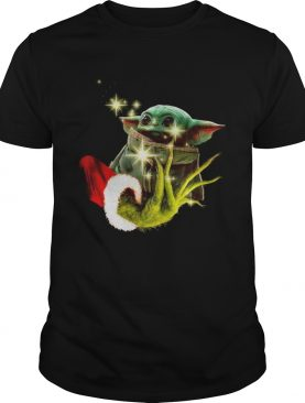 The Grinch holding a baby Yoda shirt